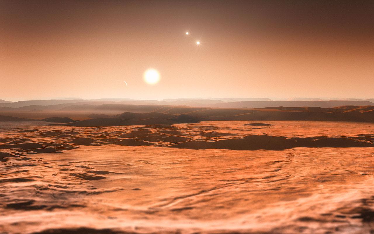 Vue d\'artiste du système de Gliese 667 vu depuis la surface d\'une des super-Terres récemment découvertes