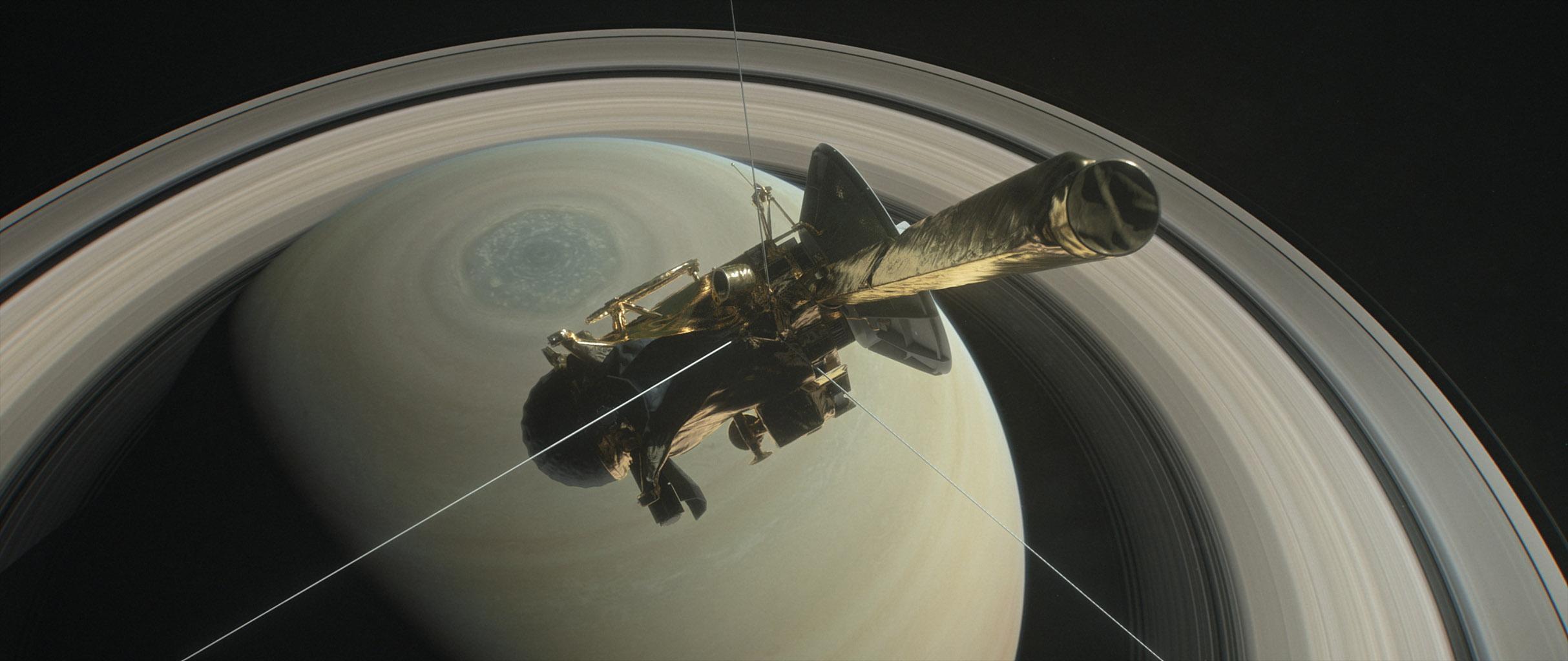 Vue d\'artiste de la sonde Cassini surplombant le pôle Nord de Saturne.